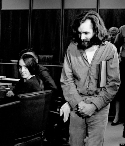 "FILE - In this Oct. 13,1970 file photo, cult leader Charles Manson walks into the courtroom as Susan Atkins, a member of his family of followers, looks on in Santa Monica, Calif. A marriage license has been issued for Manson to wed 26-year-old Afton Elaine Burton, who left her Midwestern home nine years ago and moved to Corcoran, California to be near him. Burton, who goes by the name ""Star,"" told the AP that she and Manson will be married next month. (AP Photo/File)"